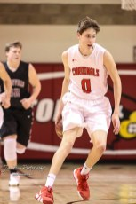 Hoisington Cardinal #0 Drew Nicholson dribbles behind his back while bring the ball down the court in the first quarter. The Hoisington Cardinals defeated the Plainville Cardinals by a score of 70 to 53 at the Hoisington Activity Center in Hoisington, Kansas on February 5, 2019. (Photo: Joey Bahr, www.joeybahr.com)