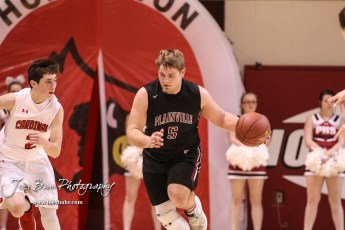 Plainville Cardinal #5 Jared Casey drives down the court with the ball in the second quarter. The Hoisington Cardinals defeated the Plainville Cardinals by a score of 70 to 53 at the Hoisington Activity Center in Hoisington, Kansas on February 5, 2019. (Photo: Joey Bahr, www.joeybahr.com)