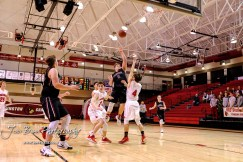 Plainville Cardinal #5 Jared Casey shoots a jump shot over Hoisington Cardinal #4 Mason Haxton in the second quarter. The Hoisington Cardinals defeated the Plainville Cardinals by a score of 70 to 53 at the Hoisington Activity Center in Hoisington, Kansas on February 5, 2019. (Photo: Joey Bahr, www.joeybahr.com)