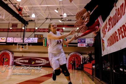 Hoisington Lady Cardinal #43 Brielle Romeiser slaps the hands of fans prior to the start of the game. The Plainville Lady Cardinals defeated the Hoisington Lady Cardinals by a score of 49 to 35 at the Hoisington Activity Center in Hoisington, Kansas on February 5, 2019. (Photo: Joey Bahr, www.joeybahr.com)