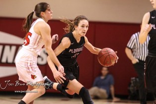 Plainville Lady Cardinal #3 Aubree Dewey drives around Hoisington Lady Cardinal #25 Maleigha Schmidt in the second quarter. The Plainville Lady Cardinals defeated the Hoisington Lady Cardinals by a score of 49 to 35 at the Hoisington Activity Center in Hoisington, Kansas on February 5, 2019. (Photo: Joey Bahr, www.joeybahr.com)