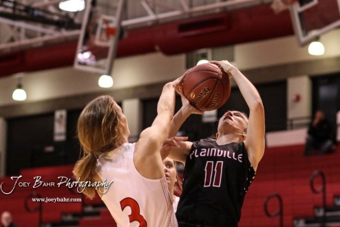 Hoisington Lady Cardinal #3 Samantha Colson tries to block a shot by Plainville Lady Cardinal #11 Kate McClellan in the second quarter. The Plainville Lady Cardinals defeated the Hoisington Lady Cardinals by a score of 49 to 35 at the Hoisington Activity Center in Hoisington, Kansas on February 5, 2019. (Photo: Joey Bahr, www.joeybahr.com)