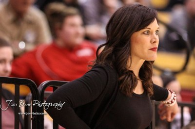 Hoisington Lady Cardinal Head Coach Mandy Mason looks on while her team is on defense in the second quarter. The Plainville Lady Cardinals defeated the Hoisington Lady Cardinals by a score of 49 to 35 at the Hoisington Activity Center in Hoisington, Kansas on February 5, 2019. (Photo: Joey Bahr, www.joeybahr.com)