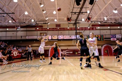 Hoisington Lady Cardinal #21 Suzanna Schneider attempts a three point shot in the fourth quarter. The Plainville Lady Cardinals defeated the Hoisington Lady Cardinals by a score of 49 to 35 at the Hoisington Activity Center in Hoisington, Kansas on February 5, 2019. (Photo: Joey Bahr, www.joeybahr.com)