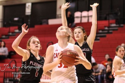 Hoisington Lady Cardinal #32 Kelsi Dalton drives to the basket in the fourth quarter. The Plainville Lady Cardinals defeated the Hoisington Lady Cardinals by a score of 49 to 35 at the Hoisington Activity Center in Hoisington, Kansas on February 5, 2019. (Photo: Joey Bahr, www.joeybahr.com)
