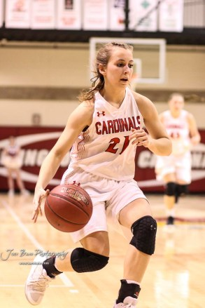 Hoisington Lady Cardinal #21 Suzanna Schneider drives to the basket in the fourth quarter. The Plainville Lady Cardinals defeated the Hoisington Lady Cardinals by a score of 49 to 35 at the Hoisington Activity Center in Hoisington, Kansas on February 5, 2019. (Photo: Joey Bahr, www.joeybahr.com)