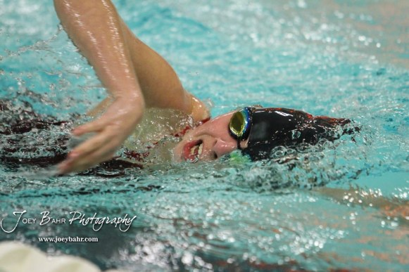 McKenna Cape takes a breathe as she swims the 500 yard Freestyle. The Great Bend Girls Swimming Invitational was held at the Kirkman Activity Center on the campus of Barton Community College in Great Bend on 4 20190426, 2019. (Photo: Joey Bahr, www.joeybahr.com)