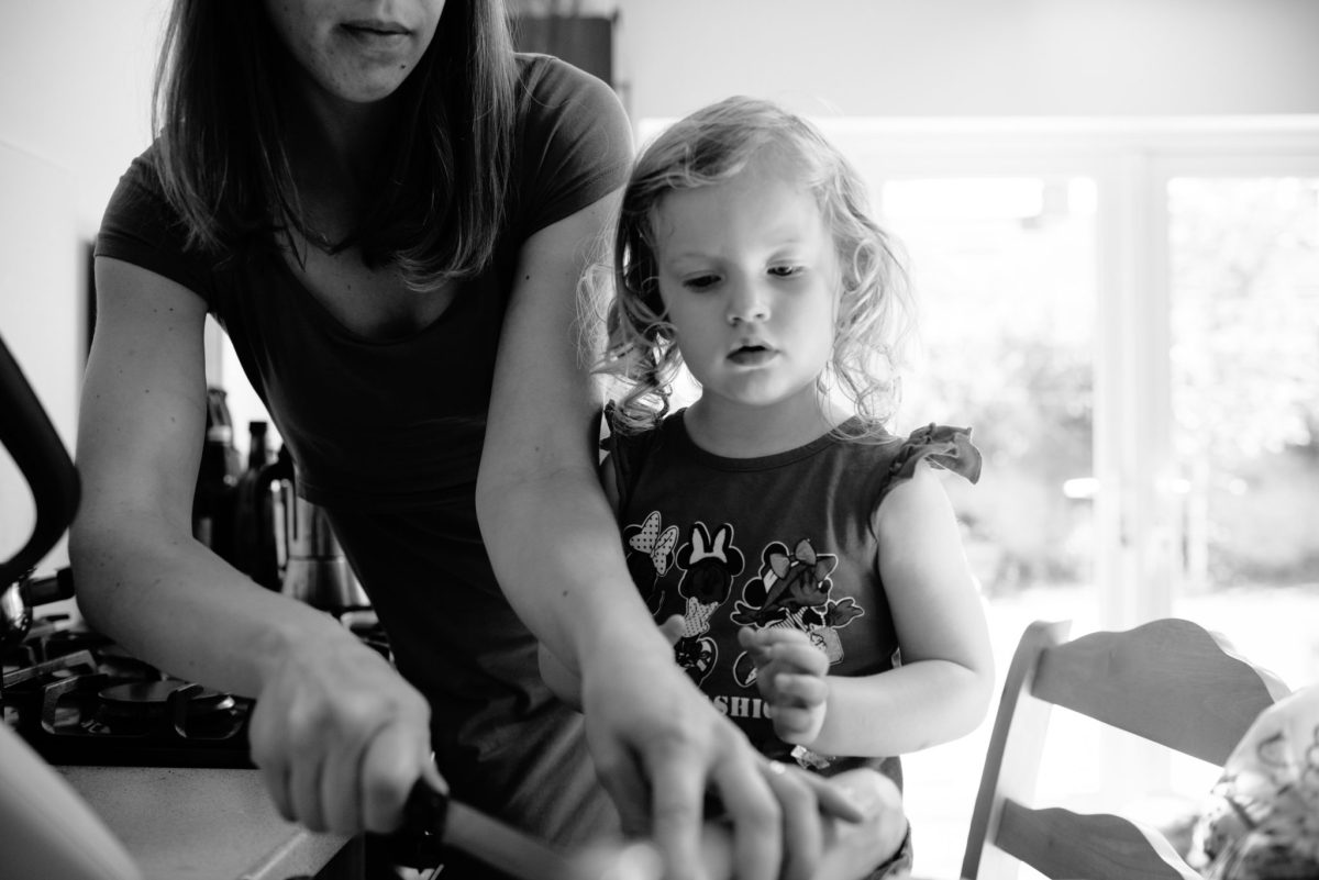 Mum and her daughter cooking together. Photograph taken with an interval timer. 5th of 8 Ways for mums to exist in family photos