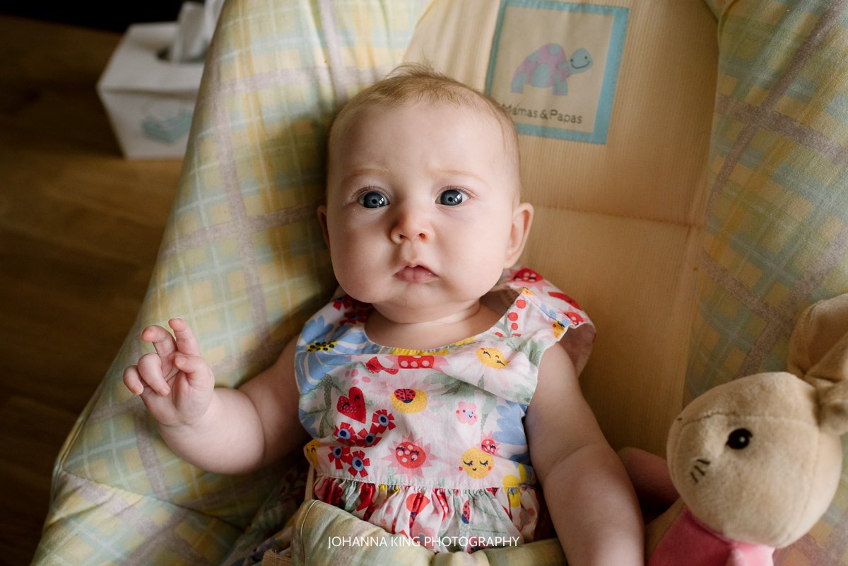 Baby girl with very cute face and chubby cheeks