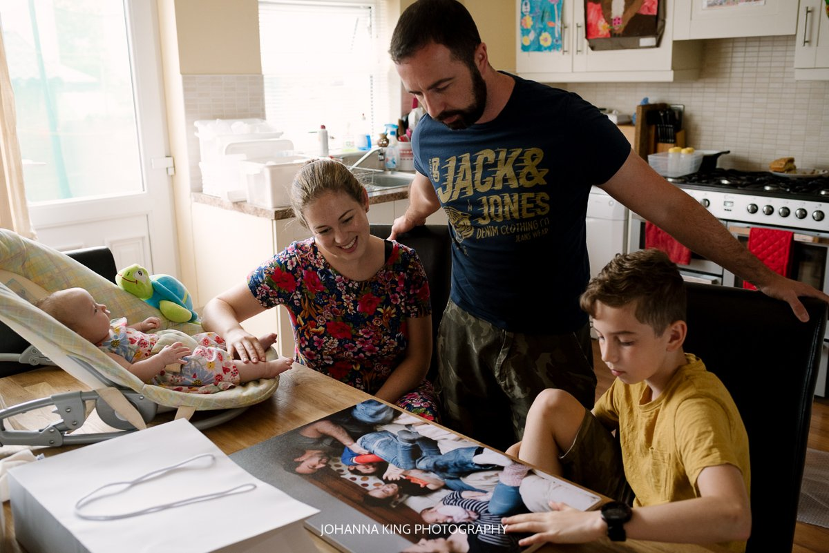 Family discovering their favourite family photo printed big