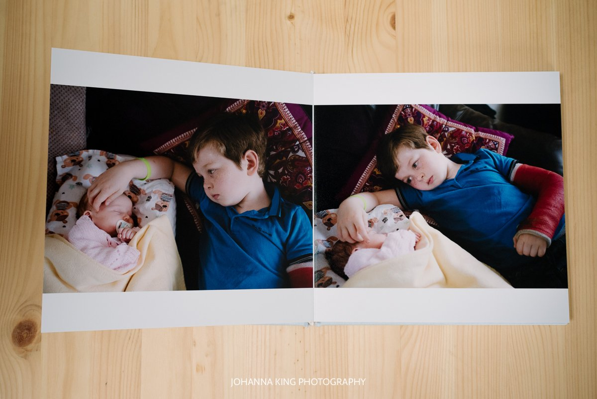 Photo Album spread with brother stroking his baby sister's head