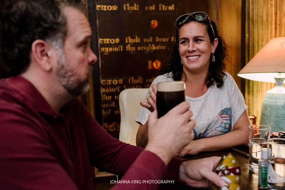 A mother and father clinking pint glasses in the pub in Dublin