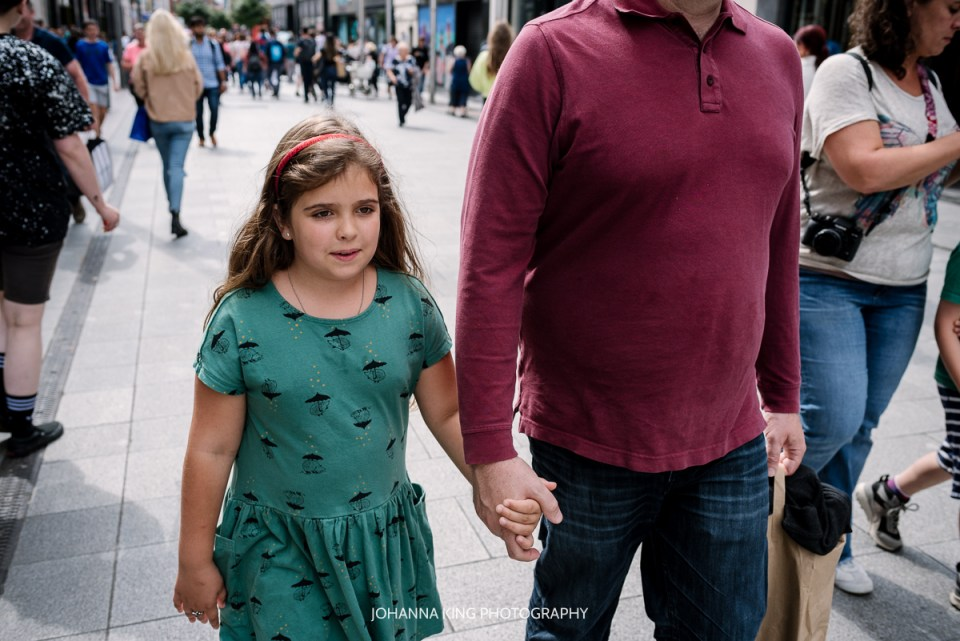 Sweet moment between father and daughter holding hands