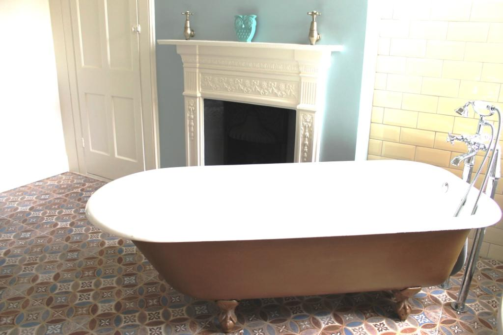 vintage bathroom styling - copper painted freestanding roll top bath