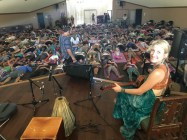 Johanna accompanying Saul David Ray yoga class at Bhakti Fest