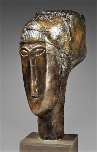 Sculpture Amedeo-Modigliani-tete-de-jeune-fille-a-la-frange