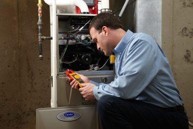 Technician repairing a heating system