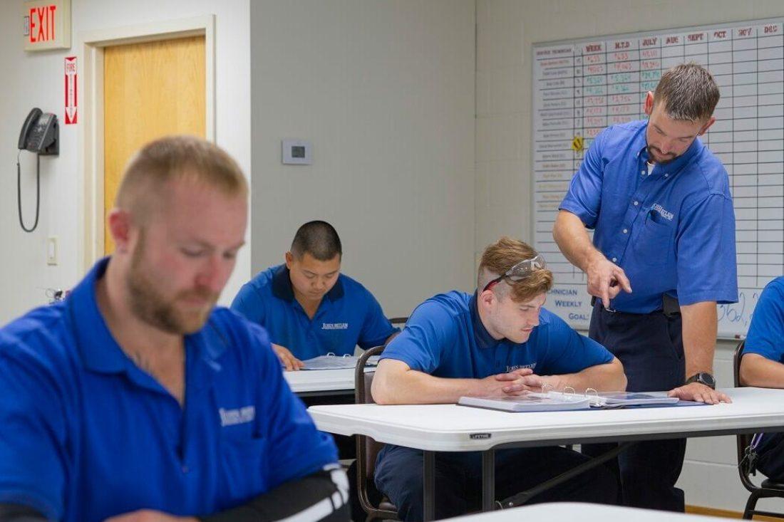 technicians learning in John Betlem HVAC's training facility