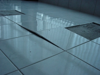 Tile Floor Movement and Expansion Joints   Problems   Tenting   Tile     another tiled floor has tented