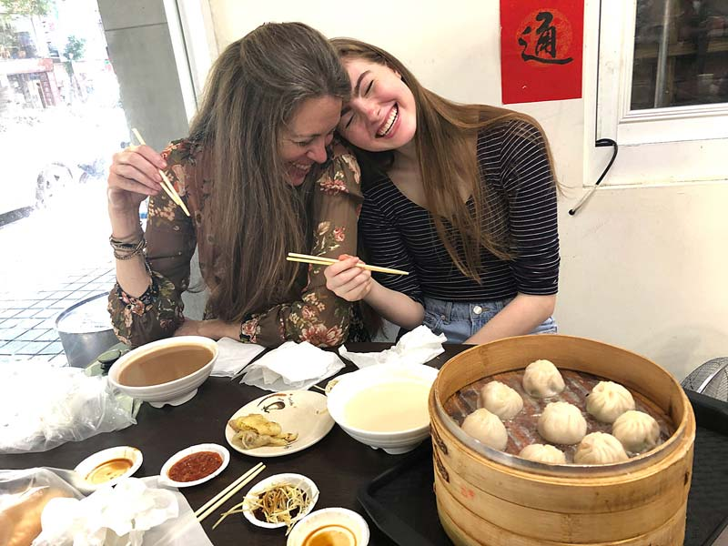 Mother and daughter enjoying Chinese food.