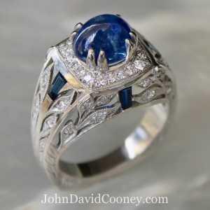 Platinum Ring, 4.14CT Sapphire, .50CT diamond accents, .60CT Sapphire Baguettes