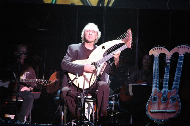 John Doan pefforms on harp guitar in concert.