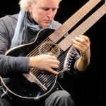 John Doan with Brunner Harp Guitar on stage in concert