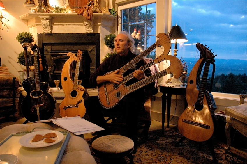 John Doan plays in a home concert with the harpolyre guitar.