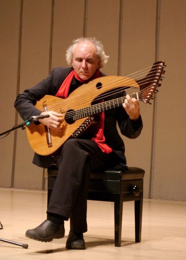 John Doan Xian China during concert playing harp guitar