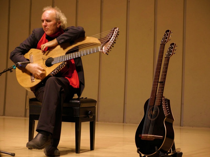 John Doan Xian China playing harp guitar on stage