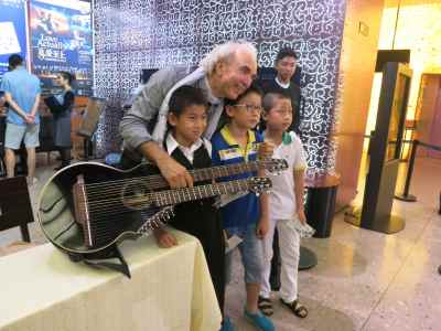 23. Xian Concert John Doan with Children