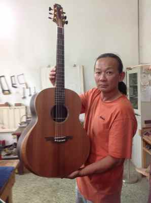 30. Mr. Xi with Guitar