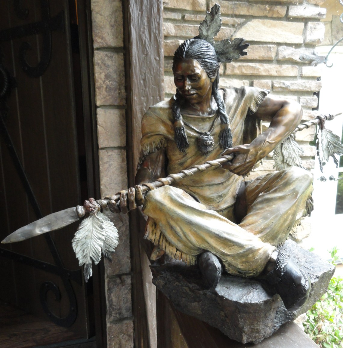 Marie Barbera Bronze seated Indian with spear