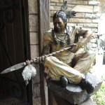Marie Barbera Bronze. Seated Indian with spear
