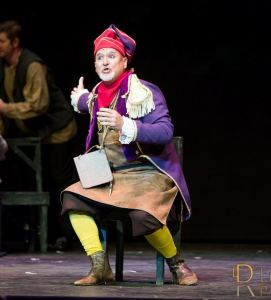John George Campbell as John George Campbell as Thenardier, introducing the audience to his band of soaks, his den of dissolutes in Master of the House.