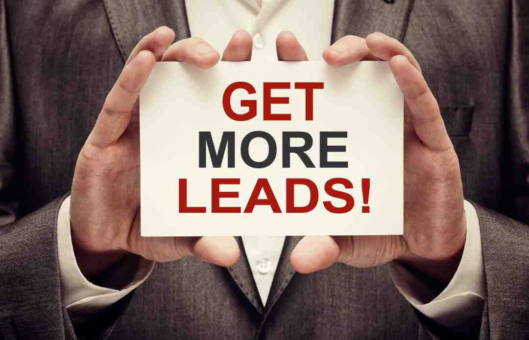 "A man holding a card that reads ""get More Leads"" for your lead generation strategy for addiction recovery services"