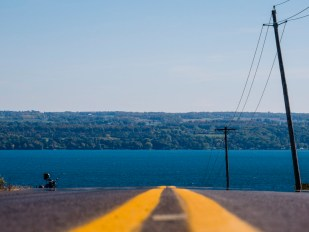 The road descends to Cayuga Lake