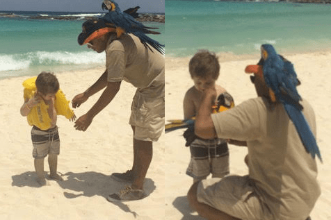 3-year-old Theiss with parrot on the beach at Club Med Cancún Yucatán