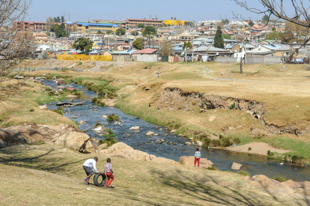 View of Jukskei River that runs through Alexandra township