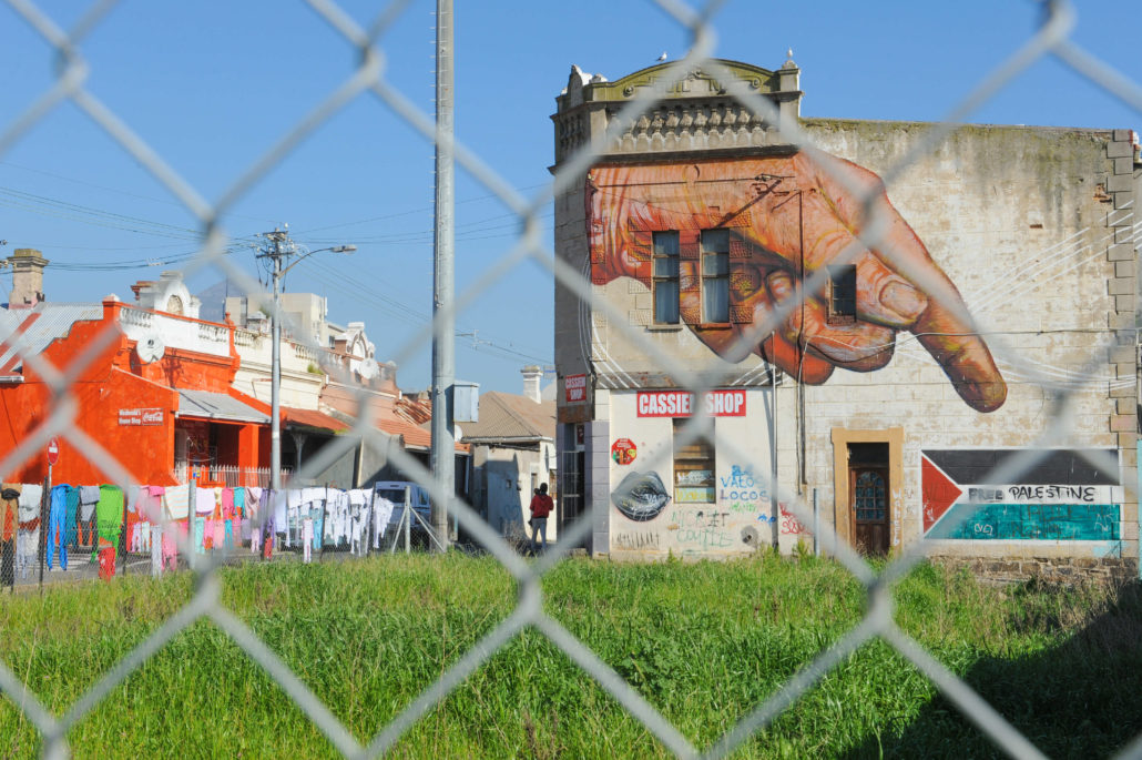Street art adorns nearly every wall in the art district of Woodstock in Cape Town