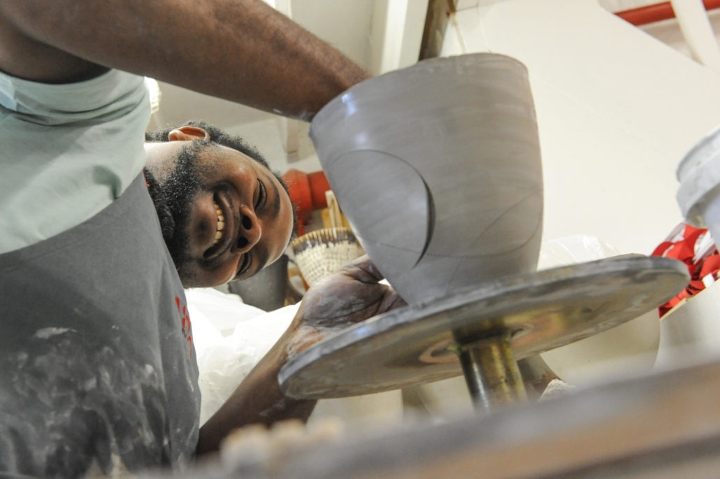 Majolandile Dyalvane, founder of Imiso Ceramics, works on one of his pieces in his studio in the Old Biscuit Mill, Woodstock