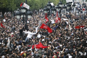 epa02532161 (FILE) A photograph dated 14 January 2011 and taken by epa photographer Lucas Dolega shows demonstrators gathering in front of the Interior Ministry during a protest against Tunisian President Zine El Abidine Ben Ali, in Tunis, Tunisia. The image was transmitted by a colleague the following day 15 January after Dolega in the course of the protests was hit by a teargas grenade and rushed to a hospital in Tunis with severe head injuries. Lucas Mebrouk Dolega, who has been working for the european pressphoto agency epa's office in Paris, France, since April 2006, died of his injuries early morning 16 January 2011 at the age of 32.  EPA/LUCAS DOLEGA