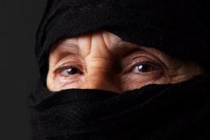 Eyes of senior muslim woman with niqab, looking at camera