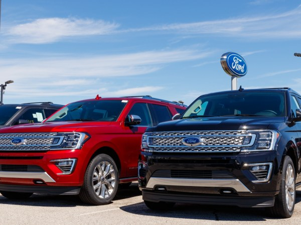 2019 model Ford SUVs parked next to each other, one red and one navy blue