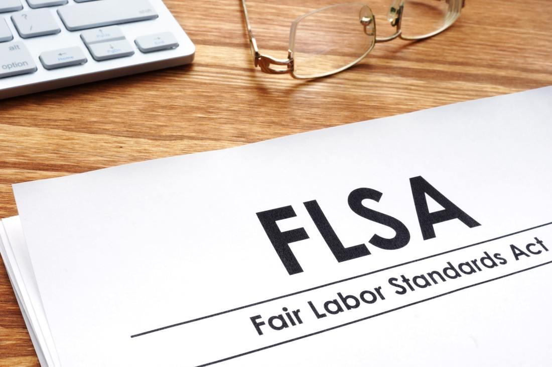 Fair Fair Labor Standards Act Lawyer standards act FLSA on a desk.