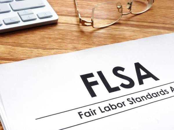 Fair Fair Labor Standards Act Lawyer standards act FLSA on a desk.