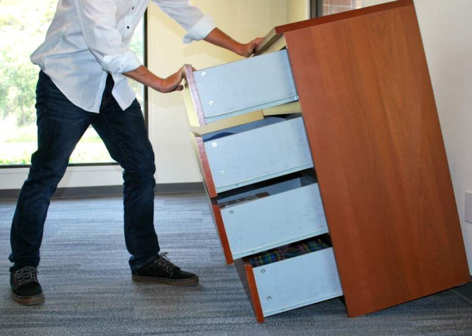 Example of furniture tip-over lawyer opening drawers on a poorly designed dresser showing instability and tipping over.