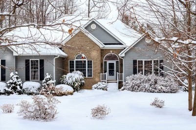 Single family home covered in snow