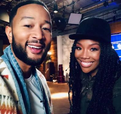 Here For It: Brandy Joins 'The Voice' As Advisor with John Legend