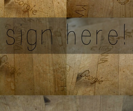 Names carved into pine dining table
